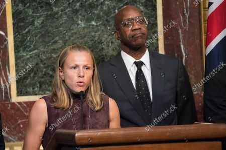 Yuliya Stepanova, a Russian athlete who helped expose widespread doping fraud in Russian sports, speaks alongside  Edwin Moses, former Olympic gold medalist and Chairman of the U.S. U.S. Anti-Doping Agency, during a press conference on proposed reforms to the World Anti-Doping Agency, including requesting that athletes be given more of a voice within the agency, at the Eisenhower Executive Office Building in Washington, D.C. on October 31, 2018.
