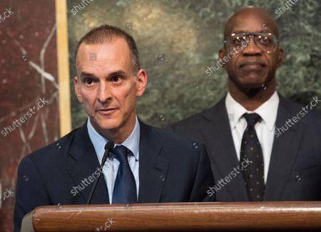 Travis Tygart (L), CEO of the U.S. Anti-Doping Agency, joined by Edwin Moses, former Olympic gold medalist and Chairman of the U.S. U.S. Anti-Doping Agency, speak on proposed reforms to the World Anti-Doping Agency, including requesting that athletes be given more of a voice within the agency, at the Eisenhower Executive Office Building in Washington, D.C. on October 31, 2018.
