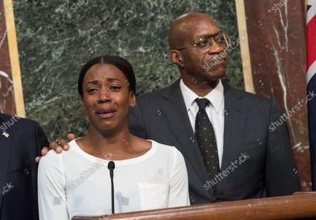 Alysia Montano, Olympic runner for the U.S, becomes emotional as she retells a story about placing fifth after two Russian athletes who were doping in the 2012 Olympics, alongside Edwin Moses, former Olympic gold medalist and Chairman of the U.S. U.S. Anti-Doping Agency, during a press conference on proposed reforms to the World Anti-Doping Agency, including requesting that athletes be given more of a voice within the agency, at the Eisenhower Executive Office Building in Washington, D.C. on October 31, 2018.
