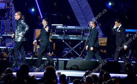 Stock Picture of Honorees Sergio Vallin, Juan Calleros, Fher Olvera and Alex Gonzalez of Mexican rock band Mana walk onstage at the Latin Grammy Person of the Year gala honoring Mexican rock band Mana at the Mandalay Bay Convention Center in Las Vegas, Nevada on  November 14, 2018.