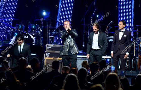 Honorees Sergio Vallin, Juan Calleros, Fher Olvera and Alex Gonzalez of Mexican rock band Mana walk onstage at the Latin Grammy Person of the Year gala honoring Mexican rock band Mana at the Mandalay Bay Convention Center in Las Vegas, Nevada on  November 14, 2018.