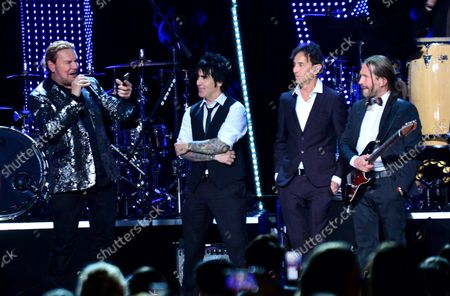 """Stock Image of (L-R) Honorees Fher Olvera, Alex Gonzalez, Juan Calleros and Sergio Vallin of Mexican rock band Mana perform """"Labios Compartidos"""" and """"Clavado en un Bar"""" onstage at the Latin Grammy Person of the Year gala honoring Mexican rock band Mana at the Mandalay Bay Convention Center in Las Vegas, Nevada on  November 14, 2018."""