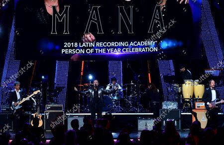"""Stock Photo of Honorees Juan Calleros, Fher Olvera, Alex Gonzalez and Sergio Vallin of Mexican rock band Mana perform """"Labios Compartidos"""" and """"Clavado en un Bar"""" onstage at the Latin Grammy Person of the Year gala honoring Mexican rock band Mana at the Mandalay Bay Convention Center in Las Vegas, Nevada on  November 14, 2018."""