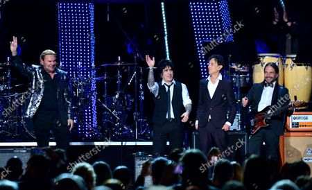 """(L-R) Honorees Fher Olvera, Alex Gonzalez, Juan Calleros and Sergio Vallin of Mexican rock band Mana perform """"Labios Compartidos"""" and """"Clavado en un Bar"""" onstage at the Latin Grammy Person of the Year gala honoring Mexican rock band Mana at the Mandalay Bay Convention Center in Las Vegas, Nevada on  November 14, 2018."""