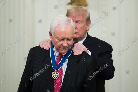 President Donald Trump awards the Medal of Freedom to retiring Senator Orrin Hatch, R-UT, during a ceremony at the White House in Washington, D.C. on November 16, 2018.