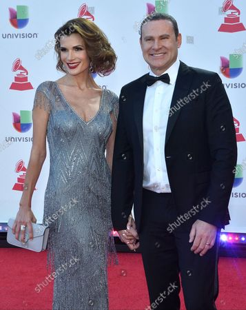 Cristina Bernal and Alan Tacher arrive on the red carpet for the 19th annual Latin Grammy Awards at the MGM Garden Arena in Las Vegas, Nevada on November 15, 2018.