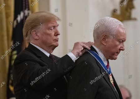 President Donald Trump awards the Medal of Freedom to retiring Senator Orrin Hatch, R-UT, during a ceremony in the East room of the White House in Washington, D.C. on November 16, 2018.