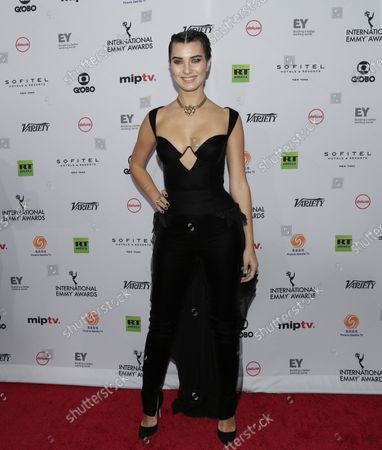 Stock Picture of Tuba Buyukustun arrives on the red carpet at the 46th International Emmy Awards at the New York Hilton in New York City on November 19, 2018.
