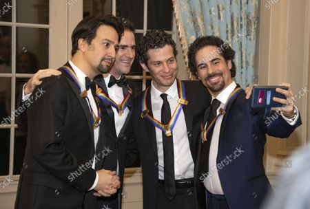 Hamilton co-creators Lin-manuel Miranda, Andy Blankenbuehler, Thomas Kail, and Alex Lacamoire, four of the recipients of the 41st Annual Kennedy Center Honors, pose for a selfie prior to sitting for a group photo following a dinner hosted by United States Deputy Secretary of State John J. Sullivan in their honor at the US Department of State in Washington, D.C. on Saturday, December 1, 2018.  The 2018 honorees are: singer and actress Cher; composer and pianist Philip Glass; Country music entertainer Reba McEntire; and jazz saxophonist and composer Wayne Shorter. This year, the co-creators of Hamilton, writer and actor Lin-Manuel Miranda; director Thomas Kail; choreographer Andy Blankenbuehler; and music director Alex Lacamoire will receive a unique Kennedy Center Honors as trailblazing creators of a transformative work that defies category.