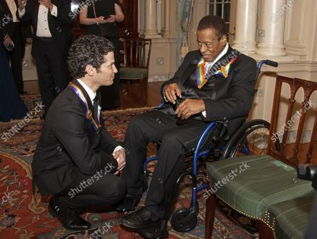 Thomas Kail, left, and wayne Shorter, right, two of the recipients of the 41st Annual Kennedy Center Honors, converse after posing for a group photo following a dinner hosted by United States Deputy Secretary of State John J. Sullivan in their honor at the US Department of State in Washington, D.C. on Saturday, December 1, 2018.  The 2018 honorees are: singer and actress Cher; composer and pianist Philip Glass; Country music entertainer Reba McEntire; and jazz saxophonist and composer Wayne Shorter. This year, the co-creators of Hamilton, writer and actor Lin-Manuel Miranda; director Thomas Kail; choreographer Andy Blankenbuehler; and music director Alex Lacamoire will receive a unique Kennedy Center Honors as trailblazing creators of a transformative work that defies category.