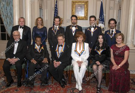The recipients of the 41st Annual Kennedy Center Honors pose for a group photo following a dinner hosted by United States Deputy Secretary of State John J. Sullivan in their honor at the US Department of State in Washington, D.C. on Saturday, December 1, 2018.  From left to right back row: Deputy Secretary of State Sullivan, Grace Rodriguez, Thomas Kail, Lin-Manuel Miranda, Andy Blankenbuehler, Alex Lacamoire. Front row, left to right:  David M. Rubenstein, Wayne Shorter, Philip Glass, Reba McEntire, Cher, and Deborah F. Rutter.  The 2018 honorees are: singer and actress Cher; composer and pianist Philip Glass; Country music entertainer Reba McEntire; and jazz saxophonist and composer Wayne Shorter. This year, the co-creators of Hamilton, writer and actor Lin-Manuel Miranda; director Thomas Kail; choreographer Andy Blankenbuehler; and music director Alex Lacamoire will receive a unique Kennedy Center Honors as trailblazing creators of a transformative work that defies category.