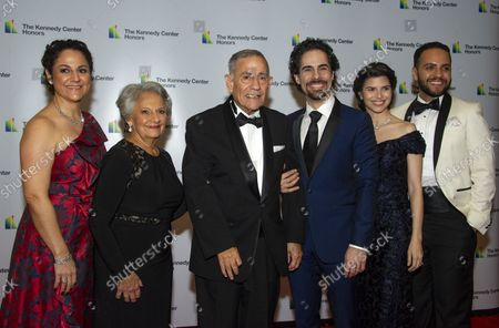 From left to right: Michelle Lacamoire, Maria Lacamoire, Alfredo Lacamoire, Alex Lacamoire, Illeana Ferreras and Juan-Torres Falcon arrive for the formal Artist's Dinner honoring the recipients of the 41st Annual Kennedy Center Honors hosted by United States Deputy Secretary of State John J. Sullivan at the US Department of State in Washington, D.C. on Saturday, December 1, 2018. The 2018 honorees are: singer and actress Cher; composer and pianist Philip Glass; Country music entertainer Reba McEntire; and jazz saxophonist and composer Wayne Shorter. This year, the co-creators of Hamilton, writer and actor Lin-Manuel Miranda, director Thomas Kail, choreographer Andy Blankenbuehler, and music director Alex Lacamoire will receive a unique Kennedy Center Honors as trailblazing creators of a transformative work that defies category.