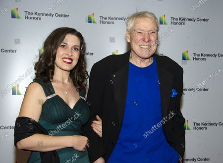 Jacques d'Amboise, right, and Emily Reid  arrive for the formal Artist's Dinner honoring the recipients of the 41st Annual Kennedy Center Honors hosted by United States Deputy Secretary of State John J. Sullivan at the US Department of State in Washington, D.C. on Saturday, December 1, 2018. The 2018 honorees are: singer and actress Cher; composer and pianist Philip Glass; Country music entertainer Reba McEntire; and jazz saxophonist and composer Wayne Shorter. This year, the co-creators of Hamilton, writer and actor Lin-Manuel Miranda, director Thomas Kail, choreographer Andy Blankenbuehler, and music director Alex Lacamoire will receive a unique Kennedy Center Honors as trailblazing creators of a transformative work that defies category.
