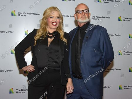 """Melissa Peterman, of """"Reba,"""" and her husband, John Brady, arrive for the formal Artist's Dinner honoring the recipients of the 41st Annual Kennedy Center Honors hosted by United States Deputy Secretary of State John J. Sullivan at the US Department of State in Washington, D.C. on Saturday, December 1, 2018. The 2018 honorees are: singer and actress Cher; composer and pianist Philip Glass; Country music entertainer Reba McEntire; and jazz saxophonist and composer Wayne Shorter. This year, the co-creators of Hamilton, writer and actor Lin-Manuel Miranda, director Thomas Kail, choreographer Andy Blankenbuehler, and music director Alex Lacamoire will receive a unique Kennedy Center Honors as trailblazing creators of a transformative work that defies category."""