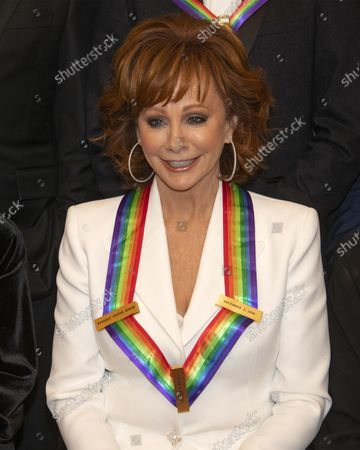 Stock Image of Rebe McEntire, one of the recipients of the 41st Annual Kennedy Center Honors, as he poses for a group photo following a dinner hosted by United States Deputy Secretary of State John J. Sullivan in their honor at the US Department of State in Washington, D.C. on Saturday, December 1, 2018. The 2018 honorees are: singer and actress Cher; composer and pianist Philip Glass; Country music entertainer Reba McEntire; and jazz saxophonist and composer Wayne Shorter. This year, the co-creators of Hamilton, writer and actor Lin-Manuel Miranda; director Thomas Kail; choreographer Andy Blankenbuehler; and music director Alex Lacamoire will receive a unique Kennedy Center Honors as trailblazing creators of a transformative work that defies category.