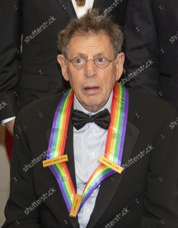 Philip Glass, one of the recipients of the 41st Annual Kennedy Center Honors, as he poses for a group photo following a dinner hosted by United States Deputy Secretary of State John J. Sullivan in their honor at the US Department of State in Washington, D.C. on Saturday, December 1, 2018. The 2018 honorees are: singer and actress Cher; composer and pianist Philip Glass; Country music entertainer Reba McEntire; and jazz saxophonist and composer Wayne Shorter. This year, the co-creators of Hamilton, writer and actor Lin-Manuel Miranda; director Thomas Kail; choreographer Andy Blankenbuehler; and music director Alex Lacamoire will receive a unique Kennedy Center Honors as trailblazing creators of a transformative work that defies category.
