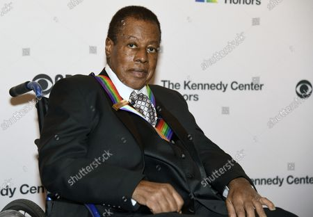Stock Photo of 2018 Kennedy Center Honoree jazz musician Wayne Shorter poses for photographers on the red carpet as he arrives for the gala at the Kennedy Center, December 2, 2018, in Washington, DC.  The Honors are bestowed annually to artists for their lifetime achievement in the arts and culture.