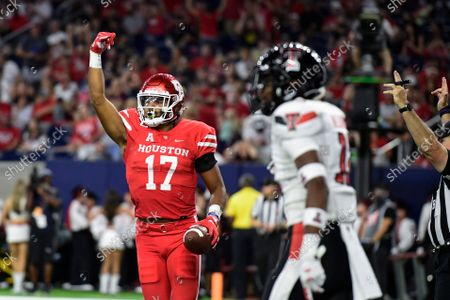 Houston tight end Seth Green (17) reacts to scoring a touchdown against Texas Tech during the first half of an NCAA college football game, in Houston
