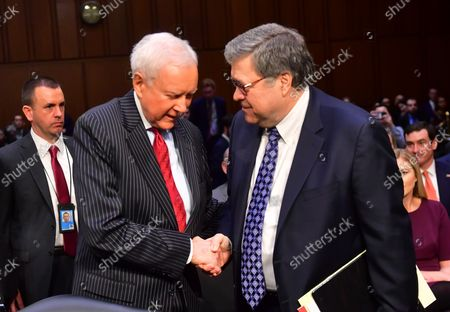 Attorney General nominee William Barr shakes hands with retired Senator Orrin Hatch (L) as he waits to testify in front of the Senate Judiciary Committee on the first of two days of his confirmation hearing on Capitol Hill in Washington, DC on January 15, 2019. Hatch endorsed and introduced Barr.   Barr will face questions regarding the use of presidential executive power and the Russian probe by the Justice Department into the 2016 national election.