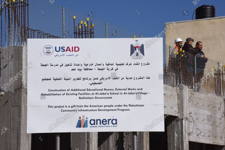Palestinian construction workers renovate and build an extension to the girl's school in Al-Jabba, near Bethlehem, West Bank, which is funded by USAid, United States Agency for International Development, January 23, 2019. The $1.4 million dollar project will be terminated at the end of January because U.S. President Donald Trump's administration will stop funding Palestinian projects and also because Palestinian Prime Minister Rami Hamdallah has stated that the Palestinian Authority will cease accepting funding from America. The school will be unusable for the 250 girl students who attend the school.
