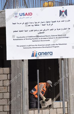 Editorial image of A Palestinian Builds A School Funded By US Aid, Al-Jabba, West Bank - 23 Jan 2019