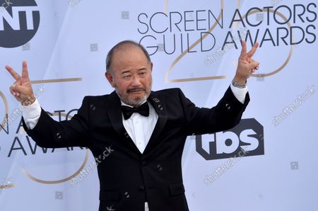 Stock Image of Clyde Kusatsu arrives for the the 25th annual SAG Awards held at the Shrine Auditorium in Los Angeles on January 27, 2019. The Screen Actors Guild Awards will be broadcast live on TNT and TBS.
