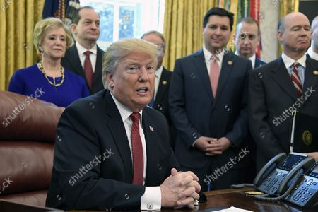 """President Donald Trump makes remarks on American manufacturing as (L-R) SBA Administrator Linda McMahon, Secretary of Labor Alex Acosta,  Rep. David Rouzer of North Carolina and Rep. Robert Aderholt (Alabama), during a meeting at the White House, Washington, DC, January 31, 2019.  Trump signed an Executive Order encouraging recipients of federal financial assistance to """"Buy American""""."""