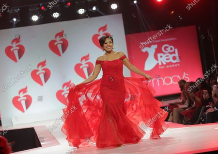 Sheinelle Jones walks on the runway at the 15th Annual Red Dress Collection fashion show on February 7, 2019 in New York City.