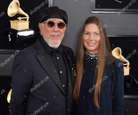 Lou Adler and Page Hannah arrive for the 61st annual Grammy Awards held at Staples Center in Los Angeles on February 10, 2019.