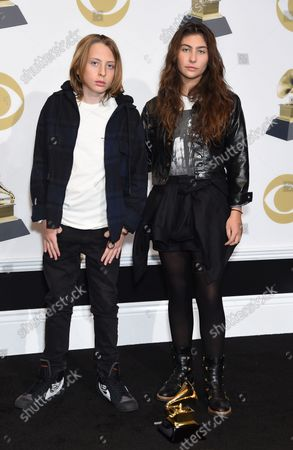 Toni Cornell (R) and Christopher Cornell (L) appear backstage with the award for Best Rock Performance for 'When Bad Does Good,' for their father Chris Cornell, during the 61st annual Grammy Awards held at Staples Center in Los Angeles on February 10, 2019.