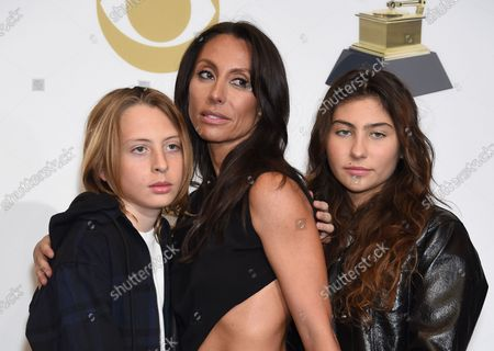 Toni Cornell (R), Christopher Cornell (L) and their mother Vicky Cornell appear backstage with the award for Best Rock Performance for 'When Bad Does Good,' for their father/ husband, Chris Cornell during the 61st annual Grammy Awards held at Staples Center in Los Angeles on February 10, 2019.