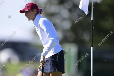 United States' Nelly Korda celebrates after a putt on the 13th hole during the foursome matches at the Solheim Cup golf tournament, in Toledo, Ohio