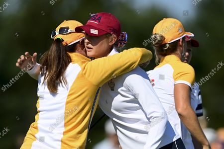 Europe's Leona Maguire hugs United States' Nelly Korda after her win on the 14th hole during the foursome matches at the Solheim Cup golf tournament, in Toledo, Ohio