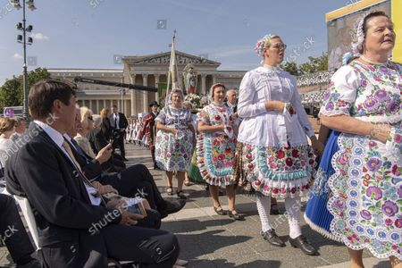 Participants of the performance entitled Hungary, the Country of Mary perform during a cultural show ahead of  the opening holy mass of the 52nd International Eucharistic Congress on the Heroes' Square in Budapest, Hungary, 05 September 2021. The International Eucharistic Congress, which had to be postponed from 2020 due to the pandemic, will be held in Budapest from 05 to 12 September. At left Hungarian President Janos Ader.