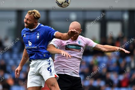 Oldham Athletic's Hallam Hope tussles with Jason Taylor of Barrow during the Sky Bet League 2 match between Oldham Athletic and Barrow at Boundary Park, Oldham on Saturday 4th September 2021.