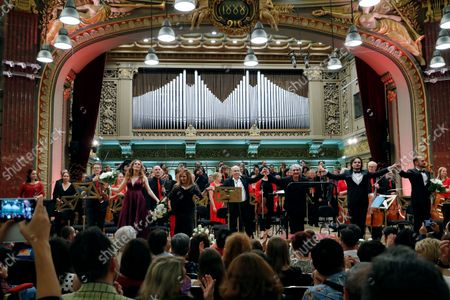 French-American soprano Emilie Rose Bry (L), Romanian-born Swiss soprano Elena Mosuc (2-L), Romanian choir conductor Iosif Prunner (3-L), Romanian conductor Nicolae Moldovenu (3-R), Romanian tenor Ioan Hotea (2-R) and Romanian bass Adrian Sanpeterean (R) salute the audience after performing Mozart's 'Great Mass in C minor K. 427', accompanied by London Mozart Players orchestra and the choir of George Enescu Philharmonic, on the stage of Romanian Athenaeum concert hall during Enescu Festival 2021, in Bucharest, Romania, 05 September 2021. The festival, held every two years since 1958, is the biggest classical music festival held in Romania and is named after Romanian composer and violinist George Enescu. The 2021 edition runs from 28 August to 26 September 2021 with the participation of 32 orchestras from 14 countries, totaling 3,500 foreign and Romanian artists. Special measures are being taken to reduce health risks for spectators and artists.