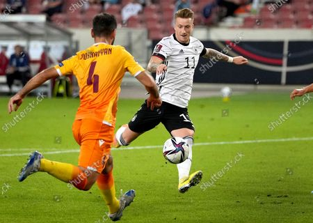Germany's Marco Reus, right scores his side's third goal during the World Cup 2022 group J qualifying soccer match between Germany and Armenia at Mercedes-Benz Arena stadium in Stuttgart, Germany
