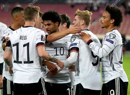 Germany's scorer Marco Reus, second left, and his teammates celebrate their side's third goal during the World Cup 2022 group J qualifying soccer match between Germany and Armenia at Mercedes-Benz Arena stadium in Stuttgart, Germany
