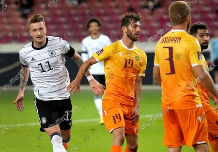 Germany's Marco Reus, left, celebrates after scoring his side's third goal during the World Cup 2022 group J qualifying soccer match between Germany and Armenia at Mercedes-Benz Arena stadium in Stuttgart, Germany