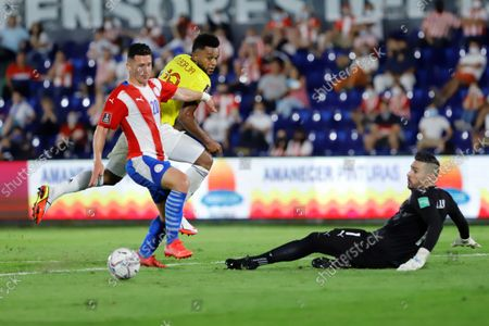 Paraguay's Jorge Morel (L) and goalkeeper Antony Silva (R) in action against Colombia's Miguel Borja during the South American soccer qualifiers for the Qatar 2022 World Cup between Paraguay and Colombia, at the Defensores del Chaco Stadium in Asuncion, Paraguay, 05 September 2021.