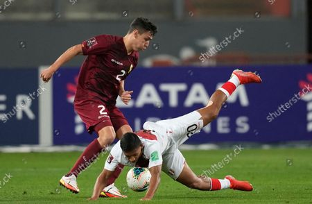 Venezuela's Nahuel Ferraresi, left, and Peru's Edison Flores fight for the ball during a qualifying soccer match for the FIFA World Cup Qatar 2022 at National stadium in Lima, Peru