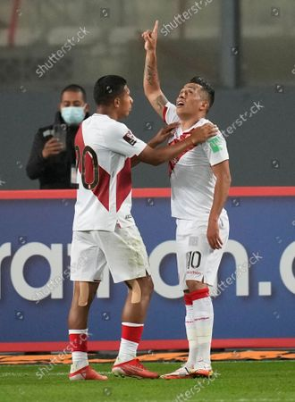 Peru's Christian Cueva, right, celebrates with Peru's Edison Flores after scoring his side's opening goal against Venezuela during a qualifying soccer match for the FIFA World Cup Qatar 2022 at National stadium in Lima, Peru