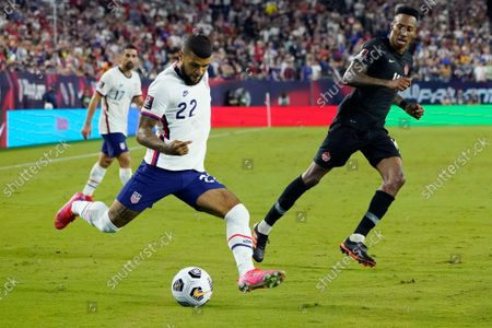 United States defender DeAndre Yedlin (22) moves the ball past Canada midfielder Mark-Anthony Kaye, right, during the first half of a World Cup soccer qualifier, in Nashville, Tenn