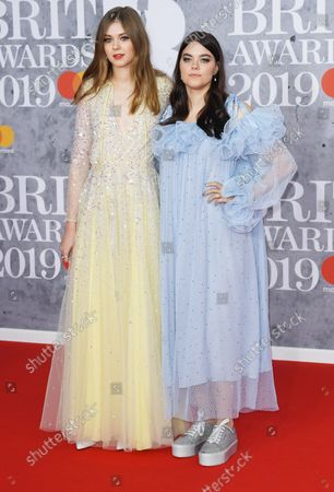 Swedish singers Klara Soderberg and Johanna Soderberg from First aid Kit attend the Brit Awards at O2 Arena in London on February 20, 2019.