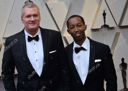 John Ottman (L) and guest arrive on the red carpet for the 91st annual Academy Awards at the Dolby Theatre in the Hollywood section of Los Angeles on February 24, 2019.