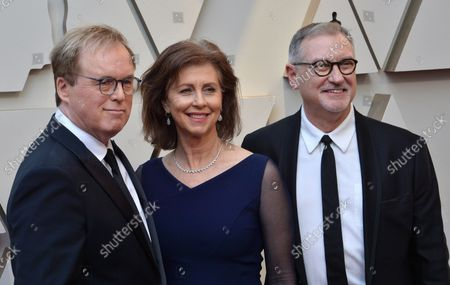 (L-R) Brad Bird, Nicole Paradis and John Walker arrive on the red carpet for the 91st annual Academy Awards at the Dolby Theatre in the Hollywood section of Los Angeles on February 24, 2019.