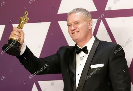 """John Ottman, winner of the award for Best Film Editing for """"Bohemian Rhapsody"""" appears backstage with his Oscar during the 91st annual Academy Awards at Loews Hollywood Hotel in the Hollywood section of Los Angeles on February 24, 2019."""