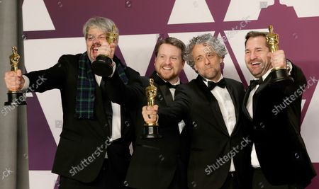 """(L-R) Ian Hunter, J.D. Schwalm, Paul Lambert, and Tristan Myles, winners of Best Visual Effects for """"First Man,"""" appear backstage with their Oscar during the 91st annual Academy Awards at Loews Hollywood Hotel in the Hollywood section of Los Angeles on February 24, 2019."""