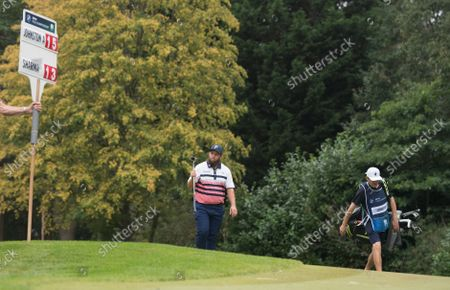 Andrew Johnston arrives to cheers from golf fans on the 16th green