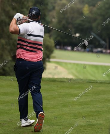Andrew Johnston drives off the 17th